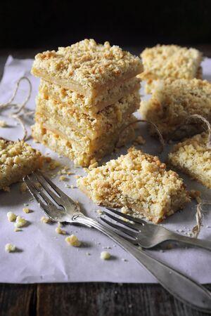 Homemade lemon bars. Grated pie crust,  short pastry on wooden background Stock Photo