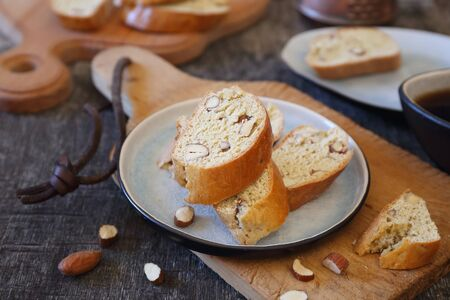 Italian biscuits: almonds biscotti and cup of coffee. Focus selective Reklamní fotografie