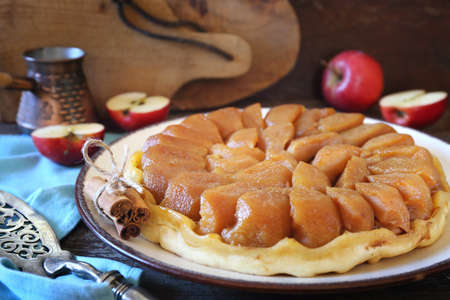French cuisine. Tart Tatin. Caramelized apple upside-down tart, rustic style
