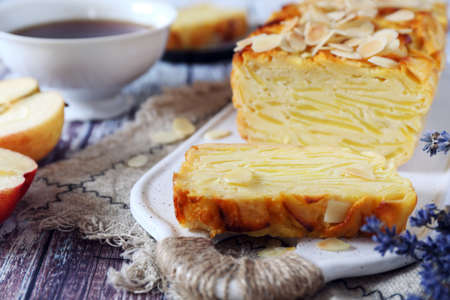 French cuisine. Invisible apple cake, almond petals dressing and cup of lavender tea