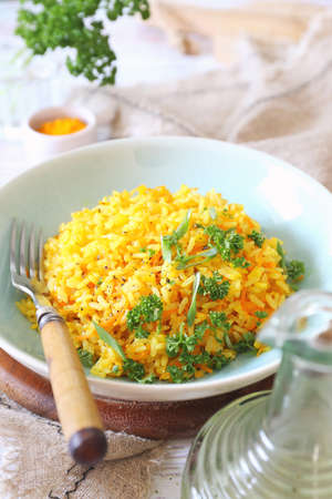 Spicy rice with carrots, green onions, olive oil and persile dressing