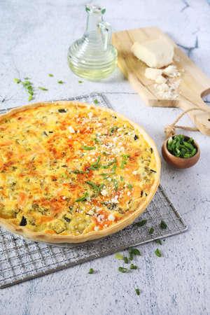 French cuisine: Zucchini and salmon quiche with parmesan cheese Archivio Fotografico