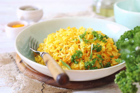 Spicy rice with carrots, green onion, olive oil and persile dressing