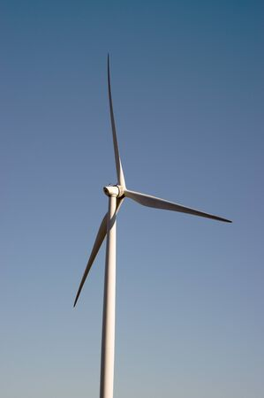 Modern windmill for electric power production with a clear blue sky