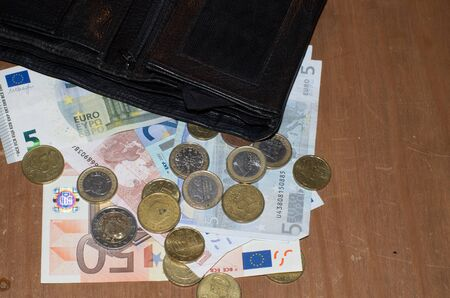 Wallet with money on a wooden table Reklamní fotografie