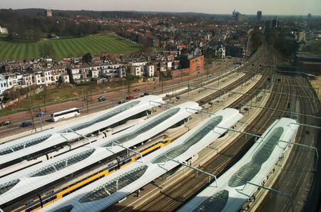 Station Arnhem in the Netherlands, with intercity train waiting view from above