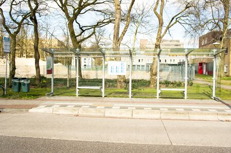 Bus stop for public transport with trees in the background in Nijmegen, Netherlands