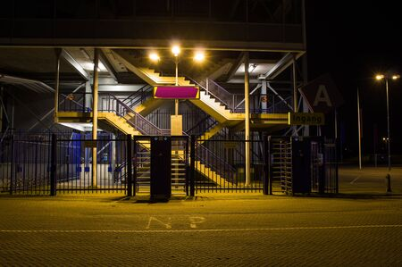 entrance to a grandstand of a large stadium at night, Gelredome in Arnhem