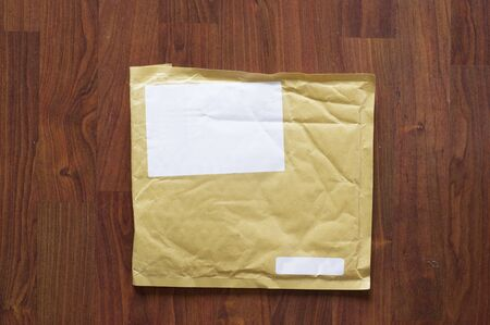 Brown air bubble envelope with empty address sticker Banque d'images