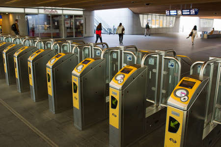 Arnhem, Netherlands - April 16, 2020: Public transport check in / out gates at central station Arnhem Éditoriale