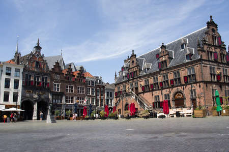 Nijmegen, Netherlands - May 21, 2020: De Grote Markt square in the center of Nijmegen, withsome people enjoy the sun