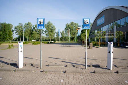 Arnhem, Netherlands - May 26, 2020: Charging station for electric cars with signs