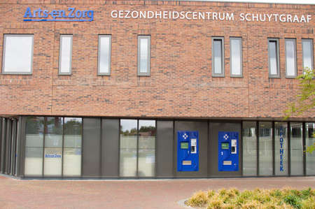 Arnhem, Netherlands - May 15, 2020:Entrance of pharmacy ArtsenZorg, in healthcare center Schuytgraaf. Translatation: Gezondheidscentrum means healthcare center and apotheek means pharmacy Éditoriale