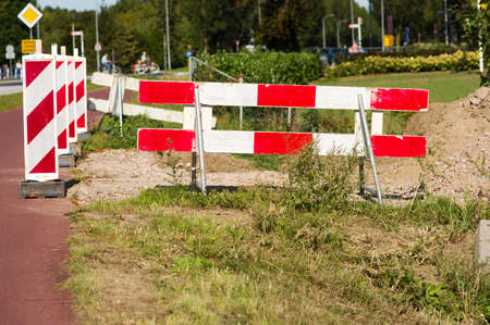 Road closed with barriers for roadworks
