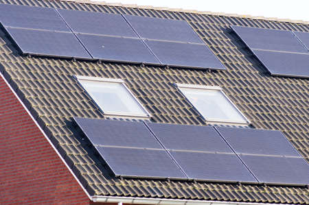 Solar panels on a brown roof for electric power generation