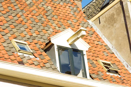 Closeup of red and black tiles on a roof of an monumental house in Zutphen, Netherlands Stock Photo