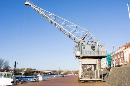 Large industrial crane in the harbor on a quay of the river Rhine in Arnhem, Netherlands