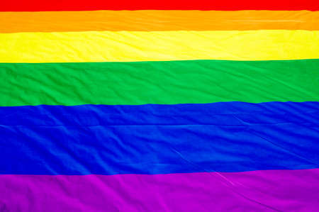 Rainbow flag, a symbol for the LGBT community on the ground