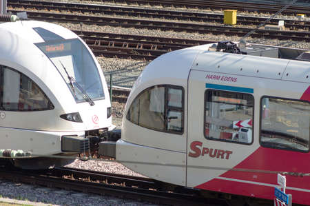Arnhem, Netherlands - June 2, 2021: Closeup of two red and white trains linked together