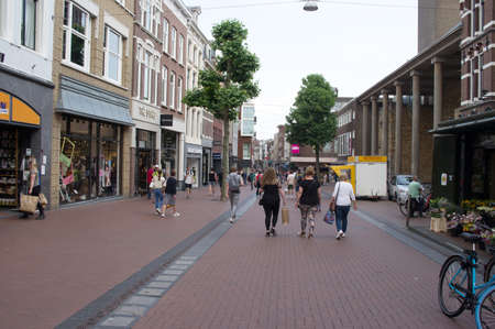 Nijmegen, Netherlands - June 26, 2021: Shopping street with many people shopping in the center of Nijmegen in the Netherlands