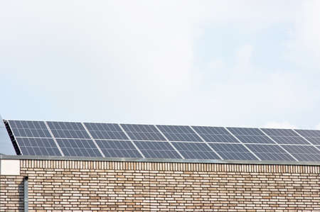 Modern solar panel on a brown roof for electric power generation