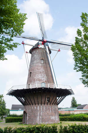 Traditional historic windmill in a residential area in the center of Oss in the Netherlands
