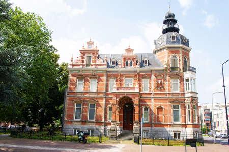 Oss, Netherlands - July 9, 2021: The historic building of the art musuem Jan Cunen in the center of Oss Redactioneel