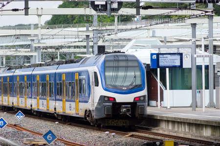 Arnhem, Netherlands - July 29, 2021: Waiting train at the platform at Arnhem station Redactioneel