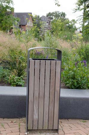 Modern wooden waste bin on the street in the Netherlands