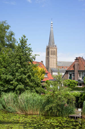 Cityscape with the Martinikerk and a pond with water lilies in the foreground in Doesburg in the Netherlands