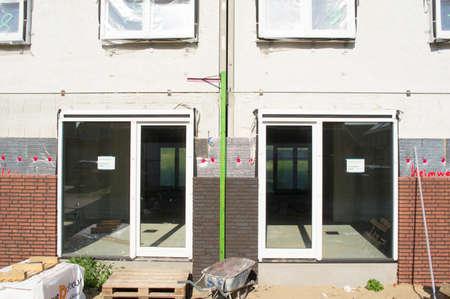 Arnhem, Netherlands - July 25, 2021: Closeup of a facade of a building under construction Redactioneel