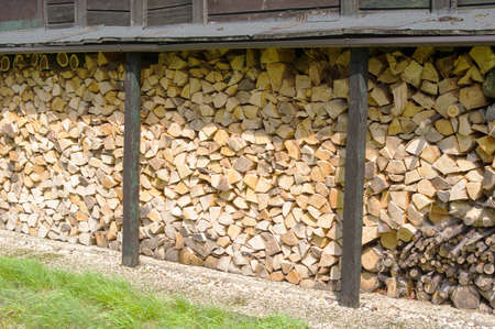 Collection stacked firewood outside for the fireplace
