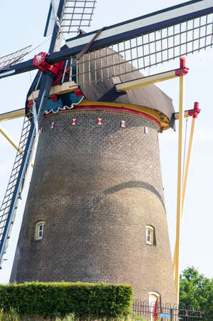 Facade of the traditional historic windmill in the center of Wijchen in the Netherlands