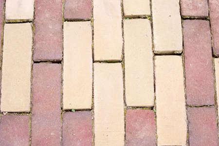 Beige and red street brick pattern background Stockfoto