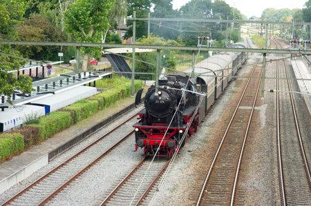 Historic black steam locomotive at Dtieren station in the Netherlands Stockfoto