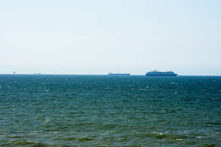 The sea with ships in the distance in the Netherlands