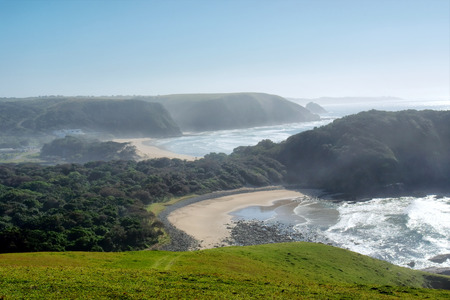 Misty beach in morning light. Shot in Coffee Bay, Eastern Cape, South Africa.