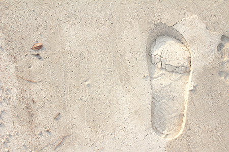 adverts: Footprints in the sand background great for vacation adverts