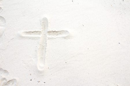 belief system: Christian cross on sand
