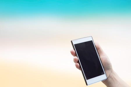 clipping  messaging: Cell phone in hand on the background blurred