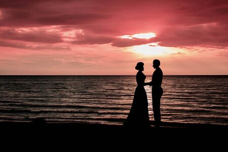 oceana: The wedding ceremony On the beach romantic longings of young everyone.Style Silhouette on the background ocean.A quiet place with two of us.