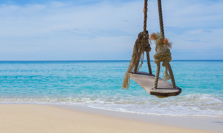 looked: Close up rope swings, benches, swings, wooden boards for relaxing on the beach. I looked at the sea in good weather Koh Kood in Thailand. Stock Photo