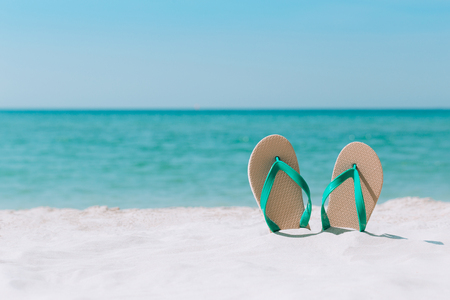 Ocean landscape And sandals on the beach. Welcome summer Stock Photo