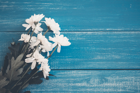 Flowers on blue wooden floors and space for text input. Vintage tone style