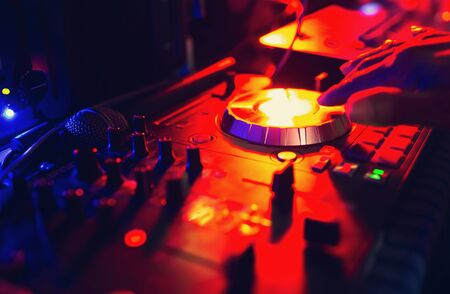 DJ remixed at a party with people in the background nightlife view of disco club Fun entertainment and fest concept