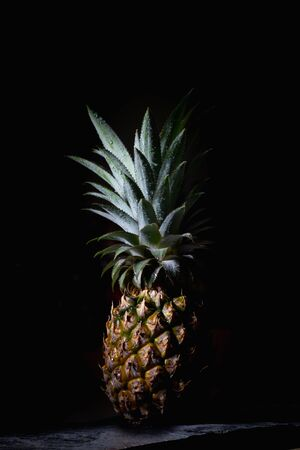 Pineapple fruit tastes good on a black background.Silhouette style
