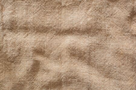 Brown sack cloth texture background with copy area Natural brown sack woven background