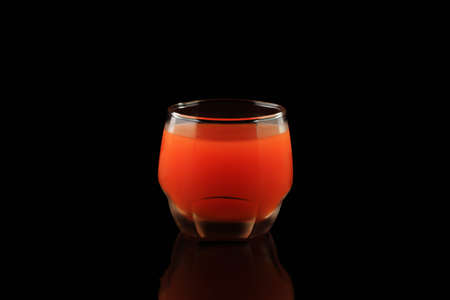 Healthy drink orange juice on black background 写真素材