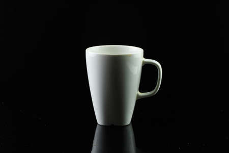 Dirty Ceramic Coffee Mug On a dark tone black background. 写真素材