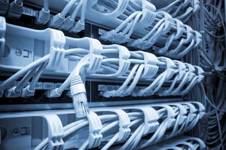 Futuristic blue server. Focus on single ethernet plug Stock Photo